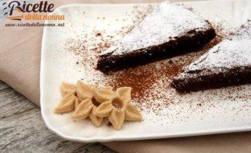 Torta cioccolato, noci e arancia