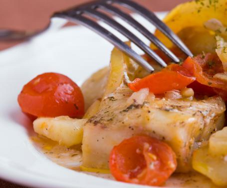 Baccalà con patate e pomodori